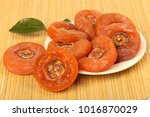 dried persimmon on dish | Shutterstock . vector #1016870029