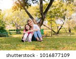 happy family playing in autumn... | Shutterstock . vector #1016877109