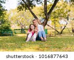 happy family playing in autumn... | Shutterstock . vector #1016877643