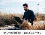 bearded casual man relaxing on...   Shutterstock . vector #1016887450