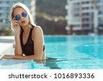 young model woman in black... | Shutterstock . vector #1016893336
