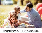 happy joyful young family... | Shutterstock . vector #1016906386