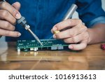 close up of the hand men hold... | Shutterstock . vector #1016913613