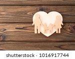 family  heart on a wooden... | Shutterstock . vector #1016917744