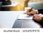 close up businessman signing... | Shutterstock . vector #1016929570