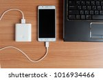 top view  plug in usb powerbank ... | Shutterstock . vector #1016934466