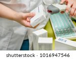 pharmacist scanning barcode of... | Shutterstock . vector #1016947546