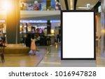 blank billboard posters in the... | Shutterstock . vector #1016947828