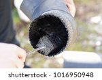 man cleaning chimney pipe... | Shutterstock . vector #1016950948
