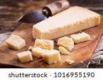 parmesan cheese on a wooden... | Shutterstock . vector #1016955190