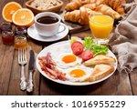breakfast with fried eggs ... | Shutterstock . vector #1016955229