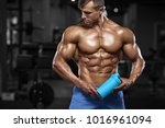 muscular man in gym with shaker ... | Shutterstock . vector #1016961094
