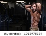 sexy strong bodybuilder... | Shutterstock . vector #1016975134