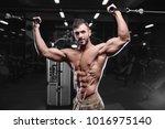 sexy strong bodybuilder... | Shutterstock . vector #1016975140