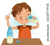 Cute boy in red shirt holding glass of  kid drinking milk.Thumbs up. Emotionally. Healthy Concepts and Growth in Child Nutrition. Vector Illustration Isolated on White background.   | Shutterstock vector #1016977978