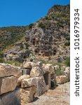 Small photo of Ancient lycian Myra rock tomb ruins at Turkey Demre
