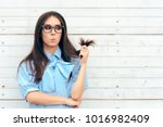 funny woman checking her hair... | Shutterstock . vector #1016982409