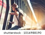 happy woman tourists in the... | Shutterstock . vector #1016988190