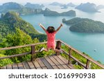 woman tourist jumping with... | Shutterstock . vector #1016990938