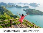 woman tourist standing posing... | Shutterstock . vector #1016990944