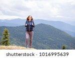 Beautiful Young Woman Hiking I...