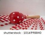 maracas is a wooden shake... | Shutterstock . vector #1016998840