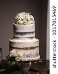wedding cake at reception | Shutterstock . vector #1017015469