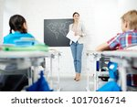 happy young teacher by... | Shutterstock . vector #1017016714