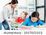 inspired schoolgirl drawing... | Shutterstock . vector #1017021313