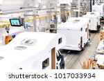 production of camper vans ... | Shutterstock . vector #1017033934