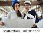 portrait two female engineers... | Shutterstock . vector #1017044770