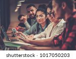 young colleagues discussing... | Shutterstock . vector #1017050203