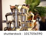 chocolate fountain close up | Shutterstock . vector #1017056590