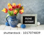red yellow tulips in blue... | Shutterstock . vector #1017074839