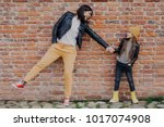small fashionable girl and her... | Shutterstock . vector #1017074908