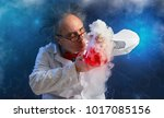 Small photo of Wacky chemist with experiment sense of smell evaluates chemicals