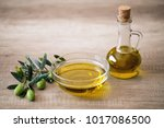 olive oil and fresh olive on... | Shutterstock . vector #1017086500