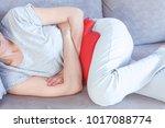 women with abdominal pain | Shutterstock . vector #1017088774