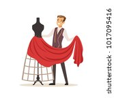 male dressmaker sewing red... | Shutterstock .eps vector #1017095416