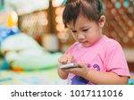 kids using smart phone   some... | Shutterstock . vector #1017111016
