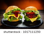 two tasty burgers with cheese... | Shutterstock . vector #1017111250