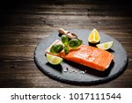 fresh raw salmon fish served on ... | Shutterstock . vector #1017111544