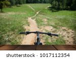 bike on the path in the park in ... | Shutterstock . vector #1017112354