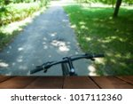 bike on the path in the park in ... | Shutterstock . vector #1017112360