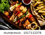 kebabs   grilled meat with... | Shutterstock . vector #1017112378