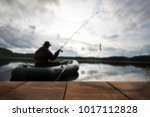 young man fishing blurred... | Shutterstock . vector #1017112828