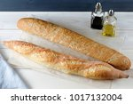 two baguette on kraft paper on... | Shutterstock . vector #1017132004