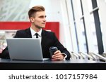 young adult businessman using... | Shutterstock . vector #1017157984