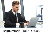 young adult businessman using... | Shutterstock . vector #1017158008