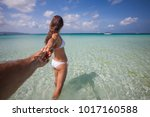 woman rests at the sea on... | Shutterstock . vector #1017160588